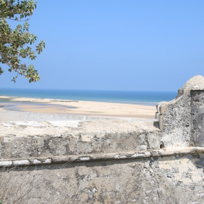 View of the beach from the wall of town