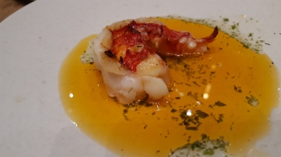 Raw Grilled Lobster Tail underneath the green